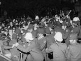 Police baton anti-tour protesters outside Parliament