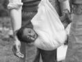 District nurse weighing baby, Waihara