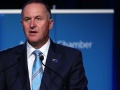 John Key wearing Silver Fern flag pin