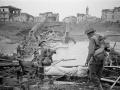NZ soldiers crossing destroyed Italian bridge